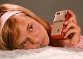 1960s Teen Girl Listening to Transistor Radio