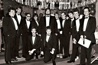 WHYT airstaff in 1986:Capt. Rick Jagger; Mark Jackson; Mike Benson; Jennifer Stevens; Bob Shuman; Dirk Hunt; Bobby Mitchell; J.J. Walker; Michael Waite and Bob Stuart. Kneeling: Hal Buttermore and Gary Berkowitz. (Click on image for larger view; photo courtesy Gary Berkowitz).