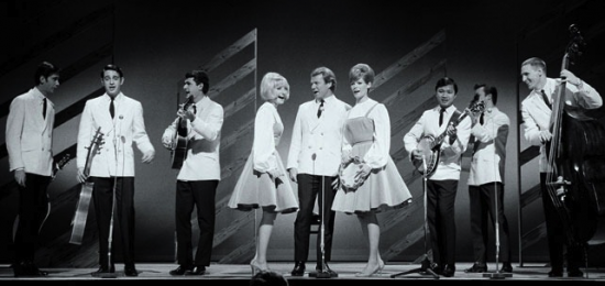 The New Christy Minstrels on stage on the Ed Sullivan Show 1963